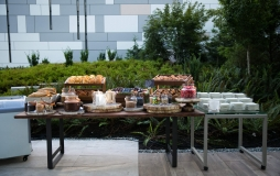 assortment of desserts & snacks on a long table at Parq Vancouver