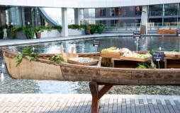 A unique spread of food on a canoe at Parq Vancouver