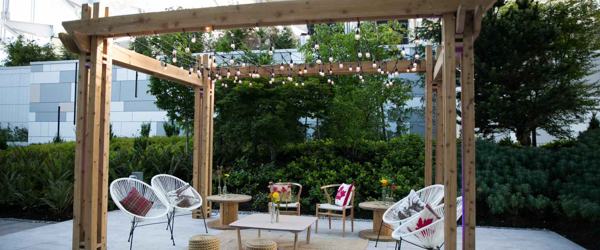 Outdoor seating area at Parq Vancouver with string lights