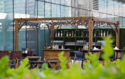 Rooftop park bar and seating at Parq Vancouver
