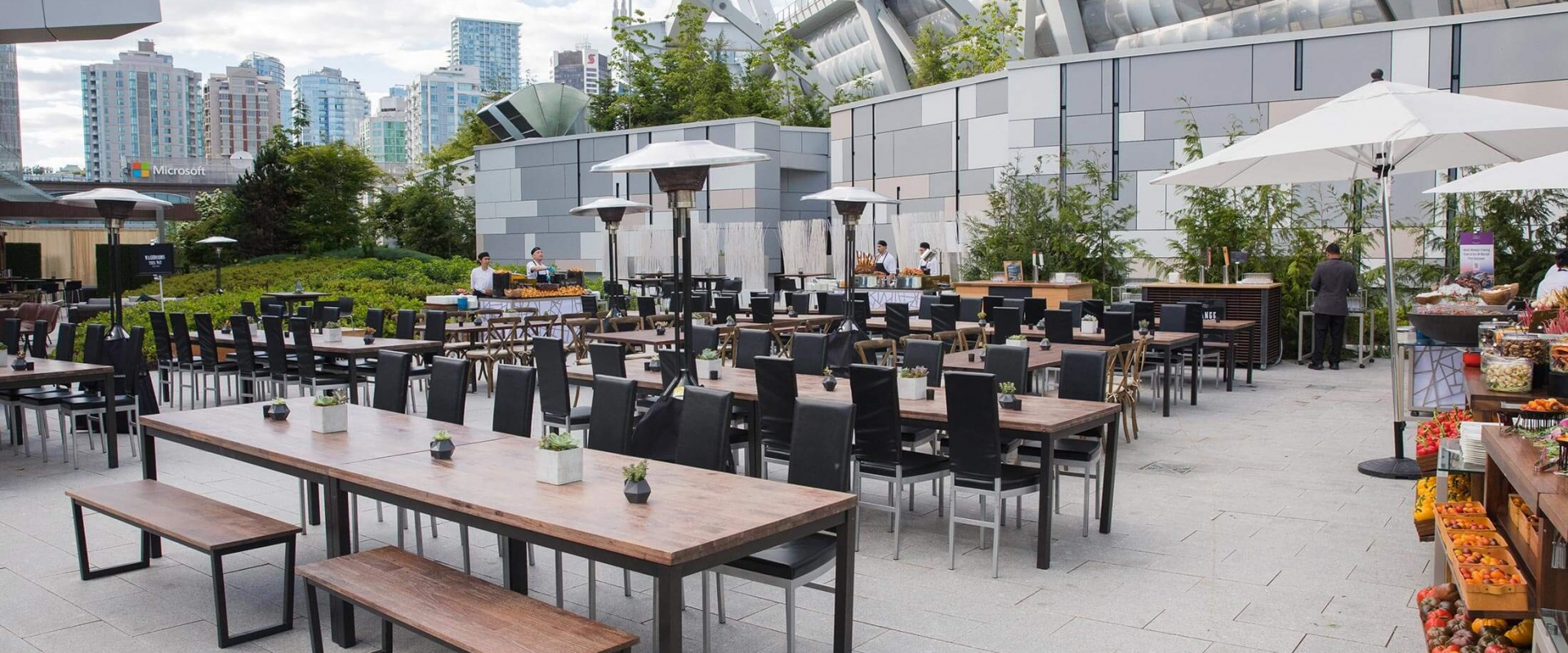 Rooftop park tables and chairs at Parq Vancouver