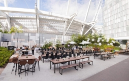 Rooftop park space with picnic tables at Parq Vancouver